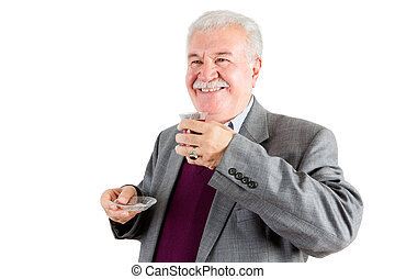 Smiling Senior Businessman with Tea Looking Out