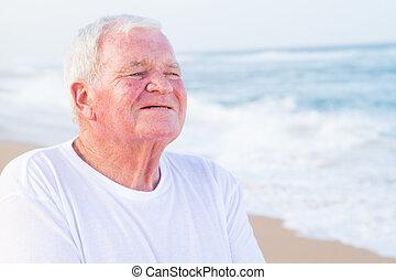smiling senior citizen - smiling male senior citizen on the ...