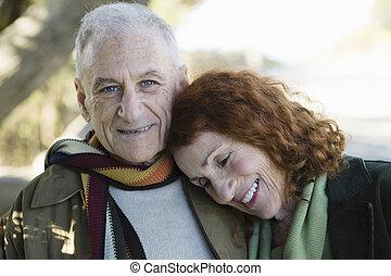 Senior Couple - Smiling Senior Couple Standing Outside in a...