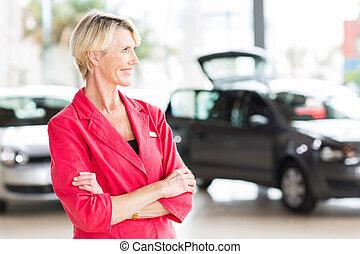 senior female car dealer principal - smiling senior female...