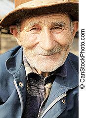 Smiling senior man in hat