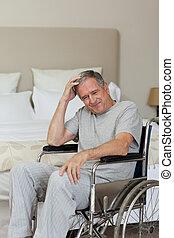Smiling senior man in his wheelchai