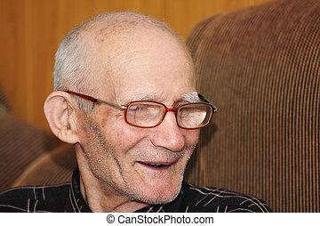 Smiling senior man indoor portrait