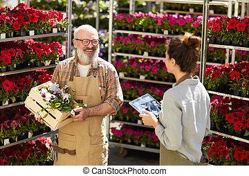 Smiling Senior Man Working at Flower Market