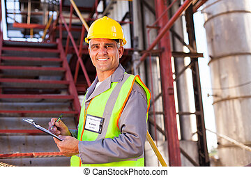 senior petrochemical worker - smiling senior petrochemical...