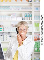 Smiling senior pharmacist