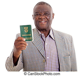smiling senior south african man holding ID book on white background