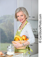 Smiling senior woman in kitchen