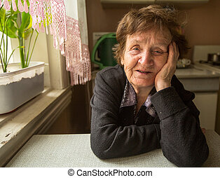 Smiling senior woman in the kitchen.