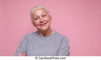 Smiling senior woman looking confident at camera.