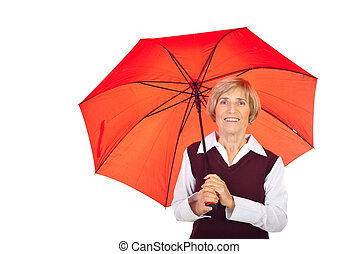 Smiling senior woman with umbrella