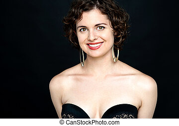 Smiling sensual woman in black fashion dress