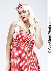 Smiling Sexy Pinup Caucasian Blond Woman in Red Old-Fashioned Dress.