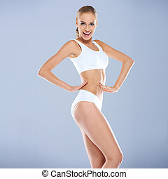 Smiling Sexy Young Woman in White Fitness Outfit