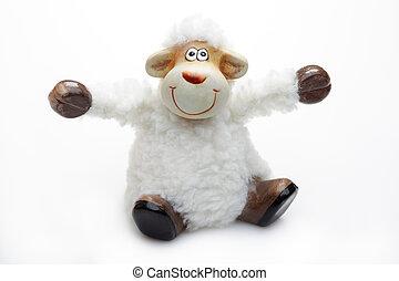 Smiling sheep toy over white background. Unsharpened image.