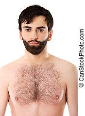 Smiling shirtless man.