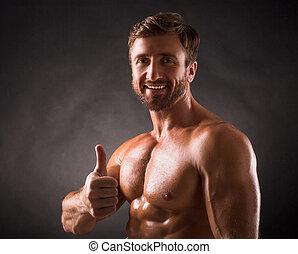 Smiling shirtless mascular man