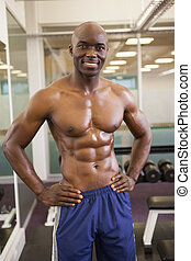 Smiling shirtless muscular man with - Portrait of a smiling...