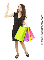 Smiling shopping woman pointing to copy space
