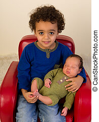 Smiling sibling with newborn brother