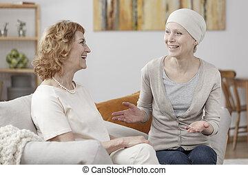 Smiling sick woman enjoying meeting