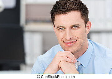 Smiling sincere young businessman