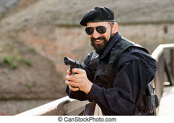 smiling soldier with gun