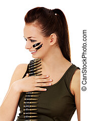 Smiling soldier woman with bullet belt
