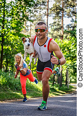 Smiling sportsman in sunglasses on the run