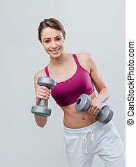 Smiling sportswoman working out
