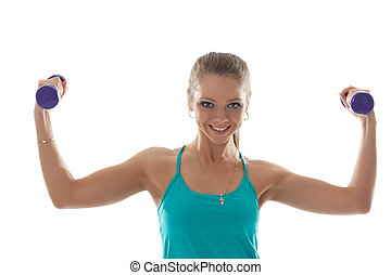 Smiling sporty girl posing with dumbbells