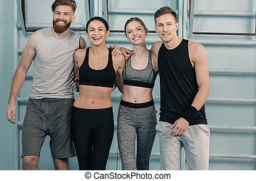 sporty men and women in gym