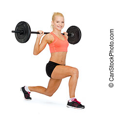 smiling sporty woman exercising with barbell - fitness, ...