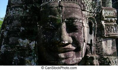 Smiling statue head shot - A medium shot of a smiling statue...