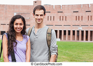 Smiling student couple posing
