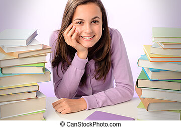 Smiling student girl between stacks of books - Smiling...