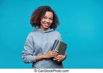 Smiling student girl in hoodie