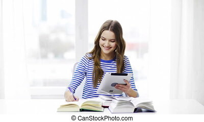 smiling student girl with tablet pc and books - education,...
