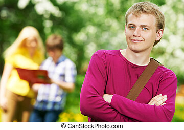 smiling student guy outdoors