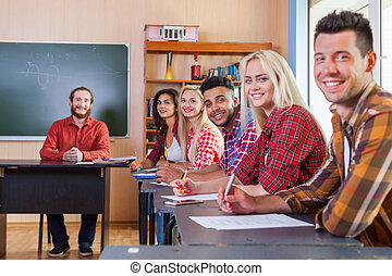 Smiling Student High School Group Write Test Looking At Camera Professor