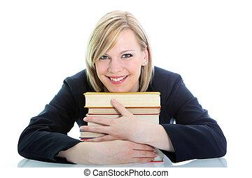 Smiling student hugging her books