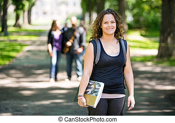 Smiling Student Standing On Campus Road