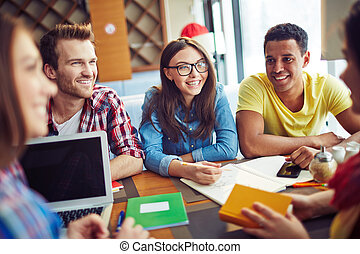 Smiling students - Group of people talking to each other