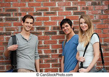 Smiling students posing