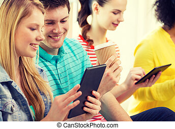smiling students with tablet pc at school - education,...