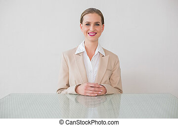 Smiling stylish businesswoman looking at camera