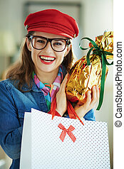 smiling stylish woman in glasses with egg and shopping bag