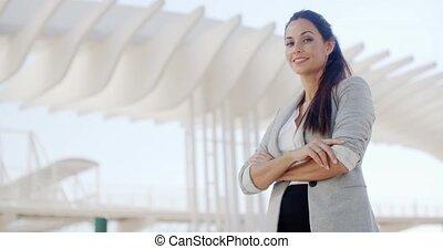Smiling stylish woman looking down at the camera