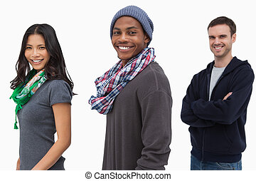 Smiling stylish young people in a row