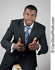 Smiling successful businessman with thumbs up